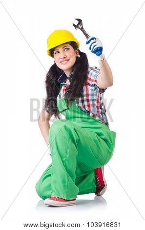 Female workman in green overalls holding key isolated on white