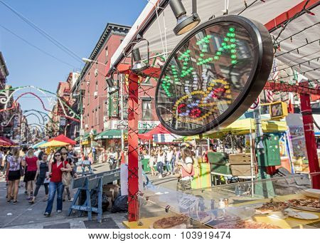 NEW YORK, USA - Sept 18th, 2015: Food vendor selling Italian food in Little Italy on Mulberry St. during the Feast Of San Gennaro. Focus is on the Pizza sign.
