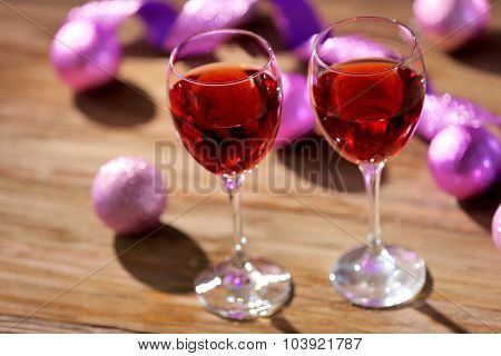 Wine and Christmas decoration on bright background