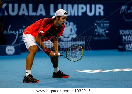 KUALA LUMPUR, MALAYSIA - SEPTEMBER 27, 2015: Yasutaka Uchiyama of Japan waits for a serve in his qualifying match at the Malaysian Open 2015 Tennis tournament held at the Putra Stadium, Malaysia.