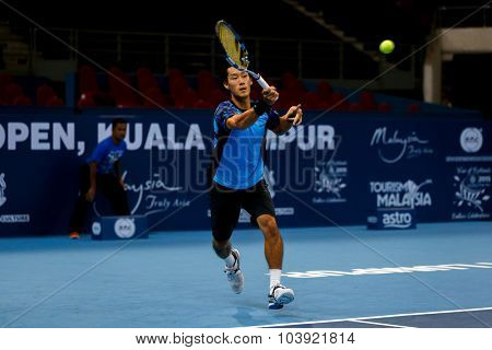 KUALA LUMPUR, MALAYSIA - SEPTEMBER 27, 2015: Yuichi Sugita of Japan plays in his qualifying match at the Malaysian Open 2015 Tennis tournament held at the Putra Stadium, Malaysia.