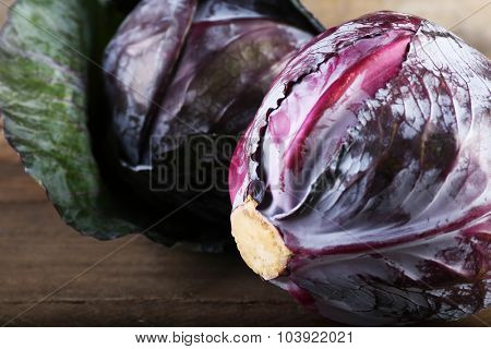 Red cabbage on wooden table, close-up