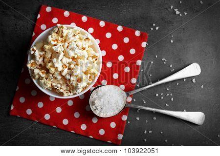 Salted popcorn in bowl on napkin