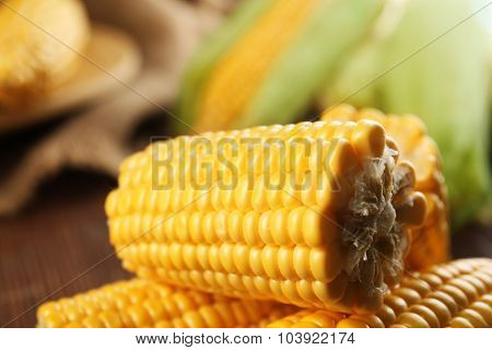 Ripe corn on wooden background