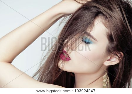 young pretty brunette woman with hair on face sexual seduction