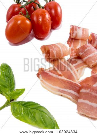 fresh snack of dry smoked ham tomato and basil isolated on white