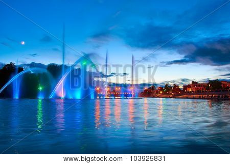 Beautiful fountain at night illuminated with blue light. Vinnyts