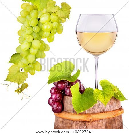 Glass of white wine with grape on a wooden barrel
