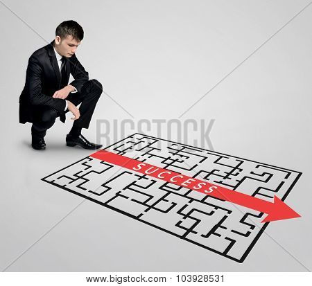 Success word maze and business man thinking solution