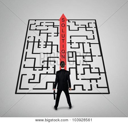 Solution word maze and business man thinking solution