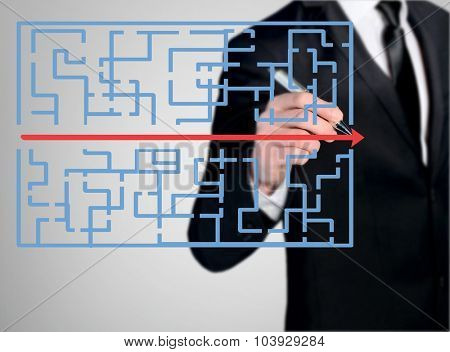 Business man close-up write maze solution