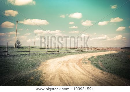 Sunny Day In Countryside. Rural Landscape With Road Under Blue Cloudy