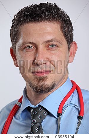 Portrait Of A Happy Handsome Mature Doctor