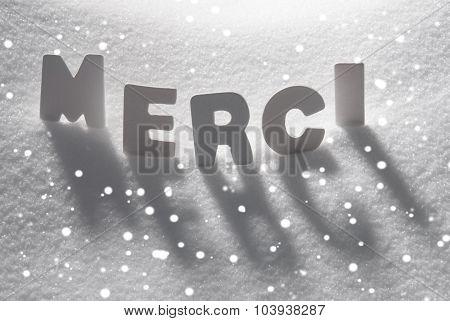 White Word Merci Means Thank You On Snow, Snowflakes