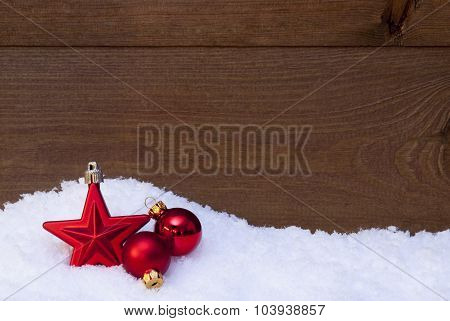 Wooden Christmas Background On Snow, Red Balls And Star
