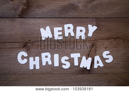 Wooden Background With White Letters Merry Christmas
