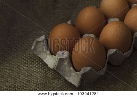 Eggs On Sackcloth Background