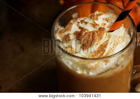 Pumpkin spice latte on moody background