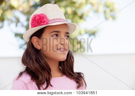 Nice child girl ten year old with a hat on the street