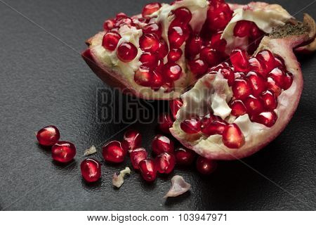 pomegranate on black background
