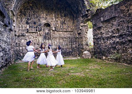 Girls Dancing In Church Ruins