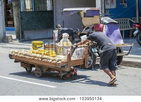 Man Pushing Heavy Cart