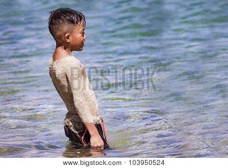 Sandy Sunscreen At The Beach