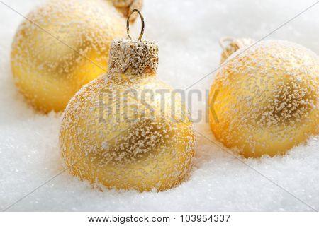 Christmas balls on snow