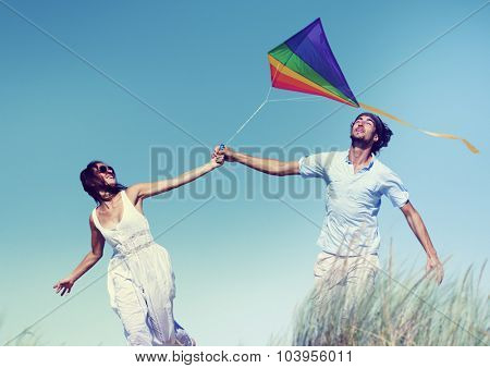 Cheerful Couple Playing Kite Summer Beach Concept