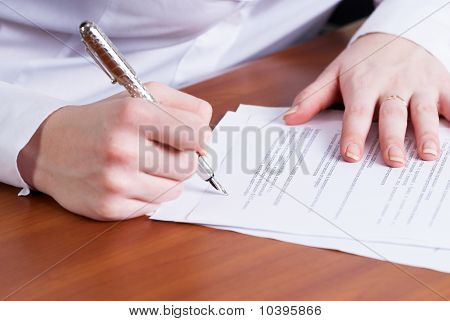 Businesswoman signing