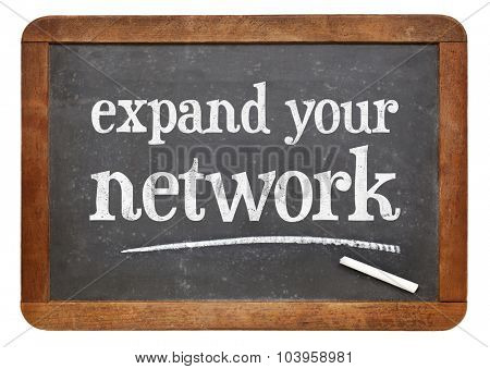 Expand your network advice  - white chalk text  on a vintage slate blackboard