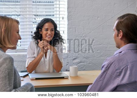 business financial advisor woman meeting with couple clients to discuss financial services