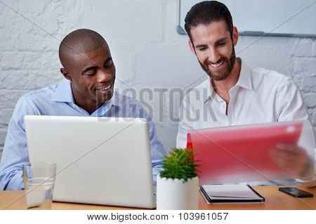 professional business men discussing future collaboration opportunities with laptop computer