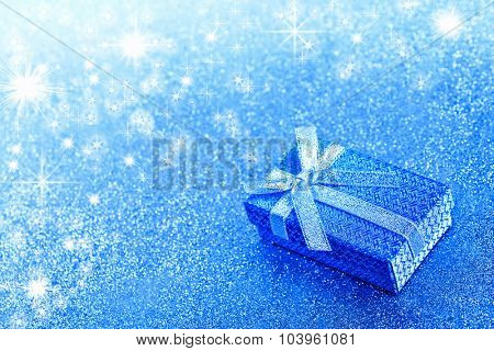 Abstract winter blue christmas background with gift box