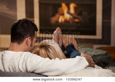 Man Sitting At Fireplace