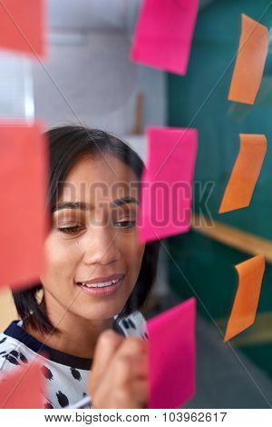 mixed race business woman brainstorming in modern office boardroom meeting