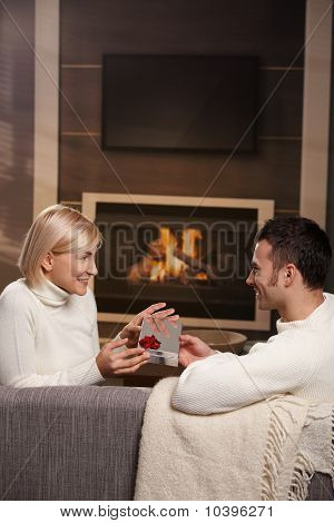 Couple Exchanging Gift At Home