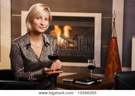 Young Businesswoman Drinking Red Wine