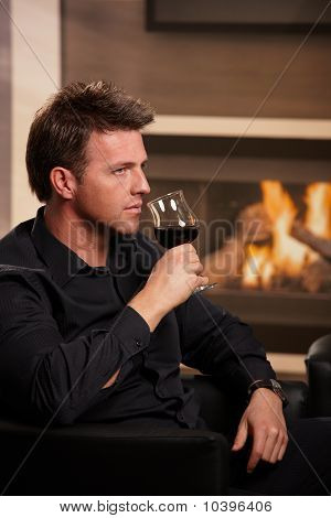 Man Tasting Wine At Home