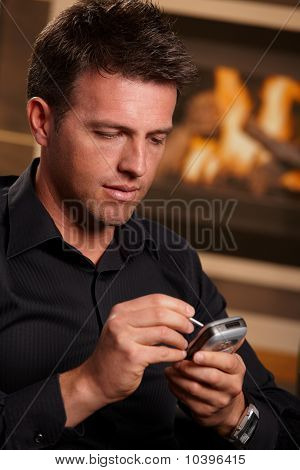 Closeup Of Businessman Using Mobile