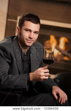 Businessman Holding Glass Of Wine