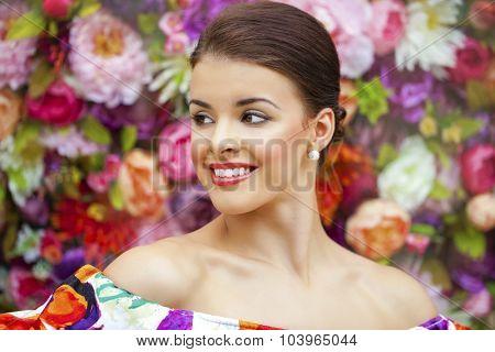 Portrait of beautiful woman in studio flowers