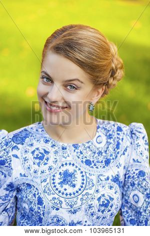 Close up portrait of a beautiful young blonde woman, outdoors
