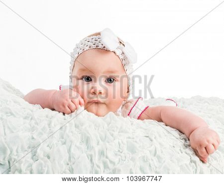 baby girl with ribbon on head on white background