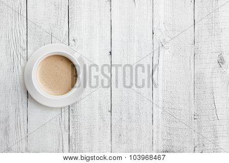 coffee cup on white wood table top view