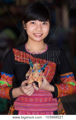 MAI CHAU, VIETNAM, DECEMBER 20, 2015 :A tourist Vietnamese girl is wearing a traditional Hmong ethnicity costume, posing in the village of Mai Chau, Vietnam.