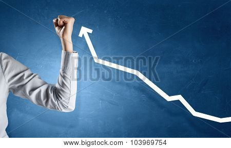 Hand showing power concept and growing graph