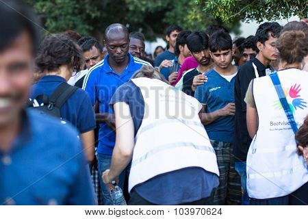 KOS, GREECE - SEP 28, 2015: Refugees receive humanitarian assistance. More than half are migrants from Syria, but there are refugees from other countries-Afghanistan, Pakistan, Iraq, Iran.