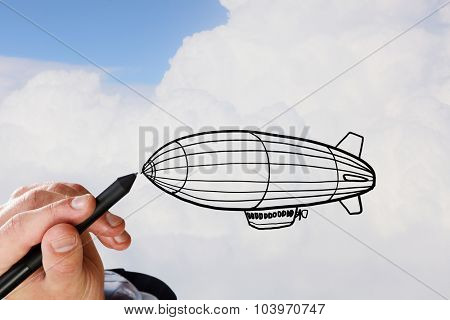 Person hand drawing aerostat on sky background