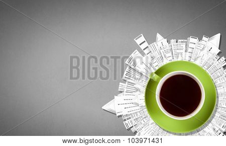 Conceptual image of cup of coffee and modern city concept